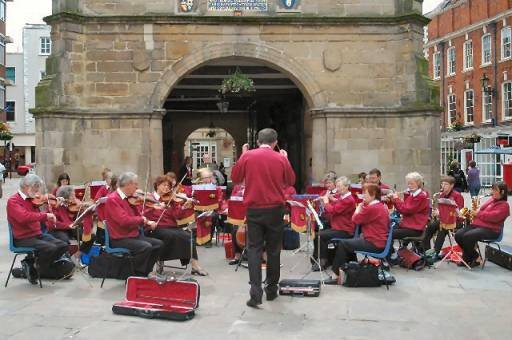 The Orchestra playing in The Square, Shrewsbury